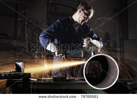 stock-photo-heavy-industry-worker-cutting-steel-pipe-with-angle-grinder-in-workshop-78769561.jpg