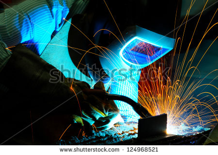 stock-photo-sparks-while-welder-uses-torch-to-welding-124968521.jpg